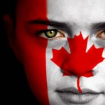 Portrait of a boy with the flag of Canada painted on his face
